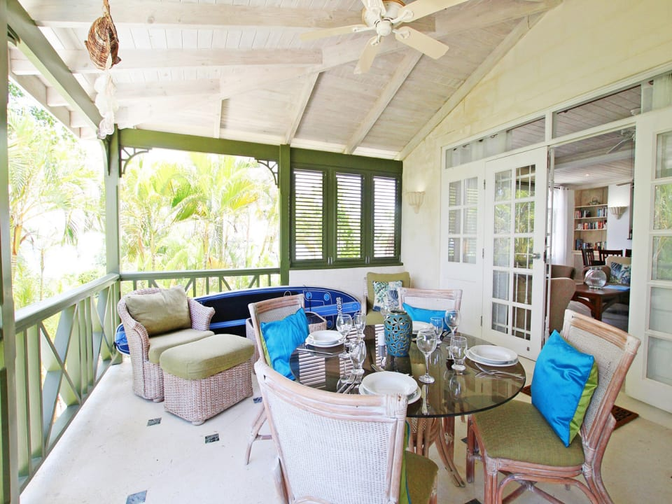 Living room opens to dining veranda with sea view on first floor