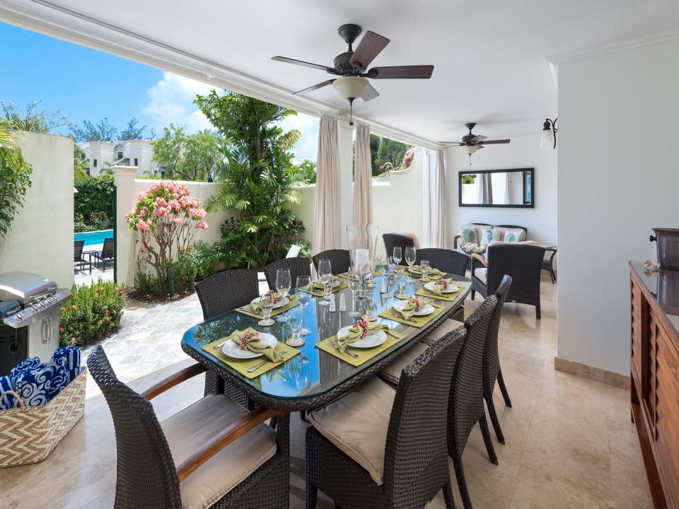 Dining terrace leads to enclosed courtyard and swimming pool beyond