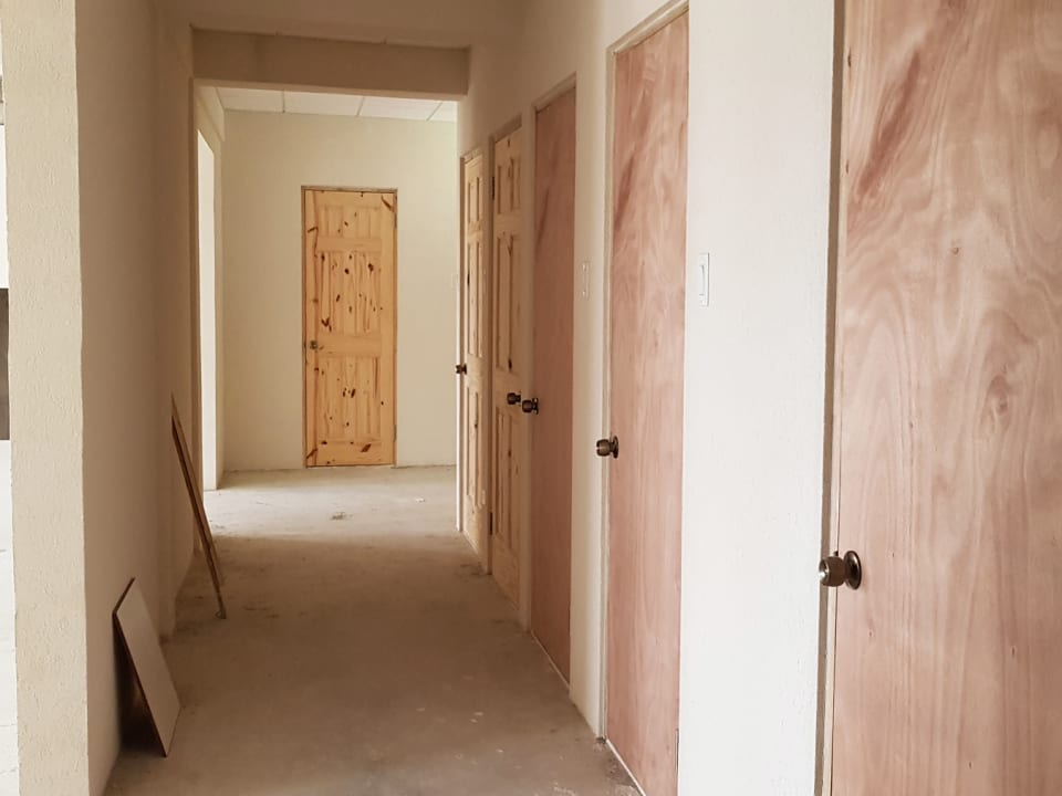 Corridor with the bathrooms and storage areas seperated