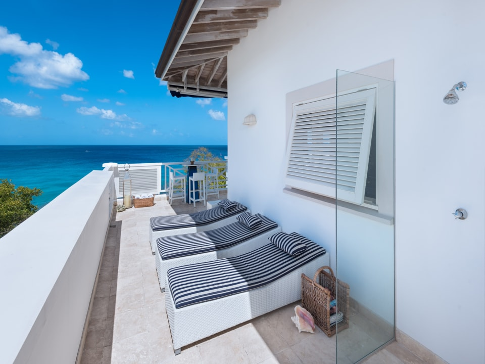 Penthouse level private sun loungers and shower