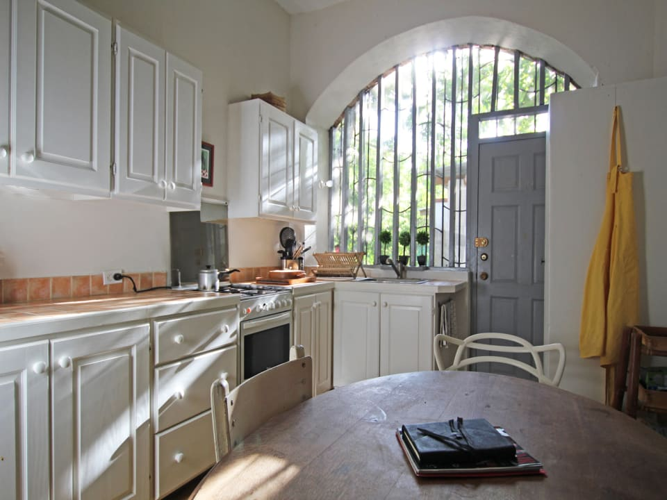 Kitchen with an intricate wooden framed window