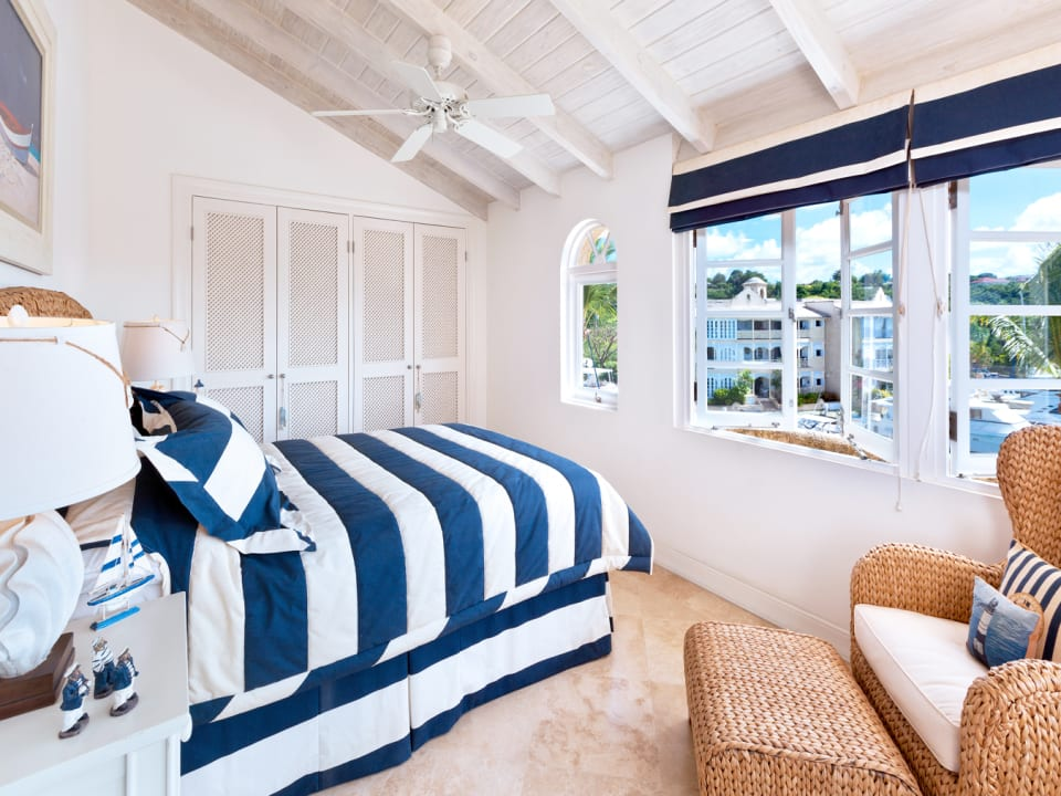 Fourth bedroom on second floor with en suite bathroom and lagoon views