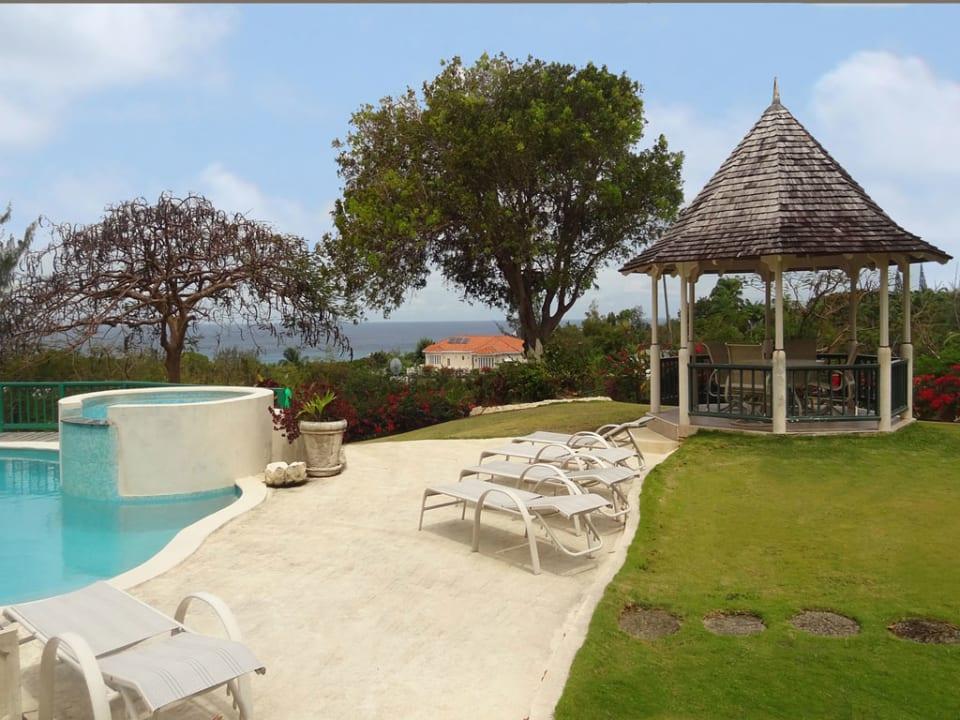 Swimming pool gazebo offering sea views