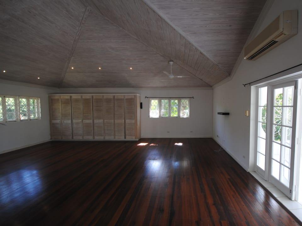 Spacious master bedroom open to a balcony