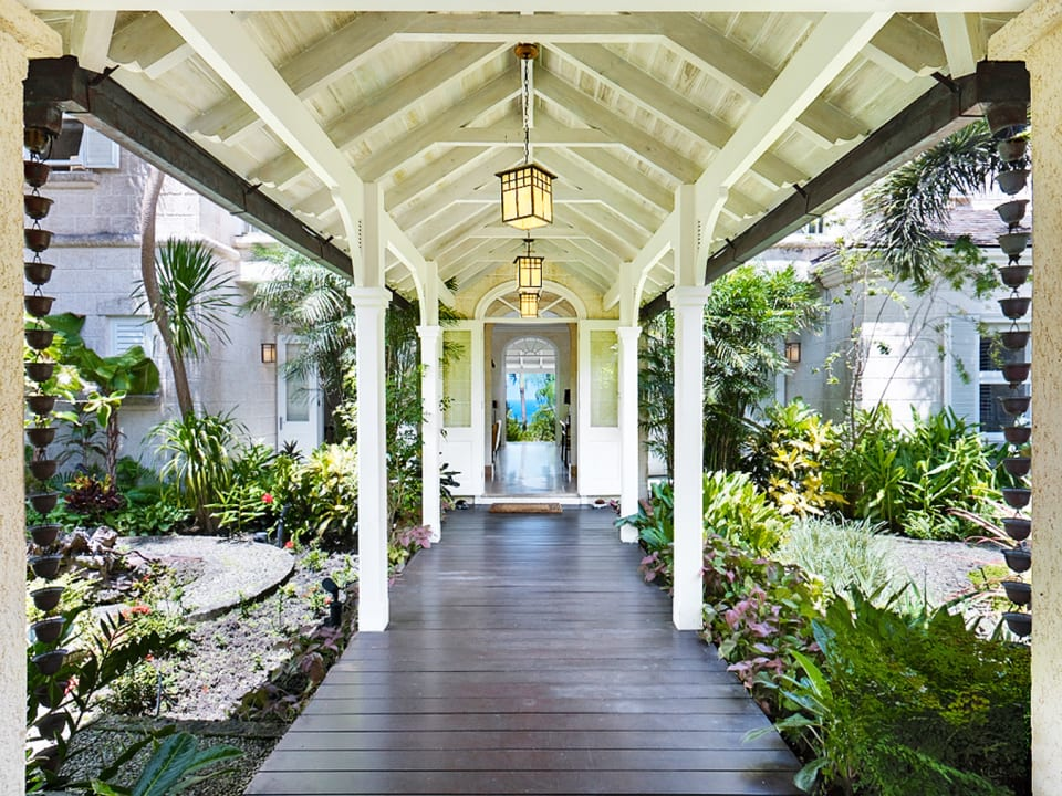 Covered entrance walkway through the tropical gardens