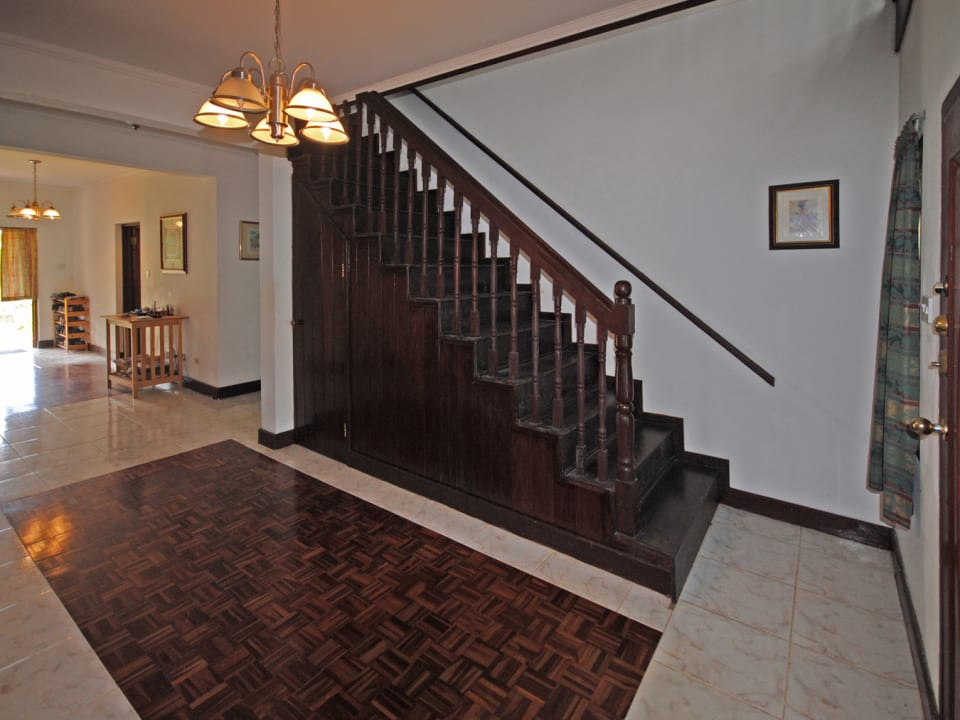 Foyer and beautiful staircase leading upstairs