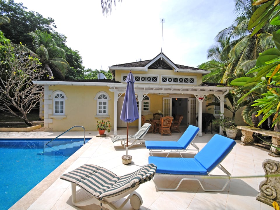View of pool terrace and Coconut Cottage
