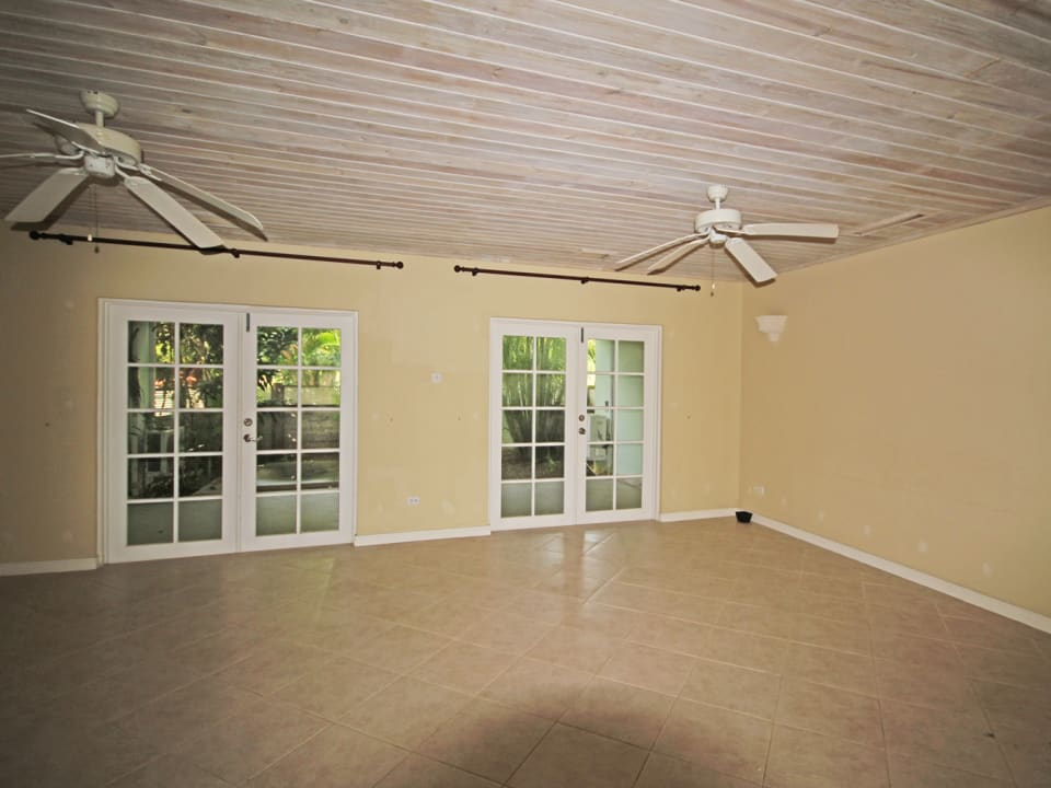 Spacious living and dining area leading out to patio
