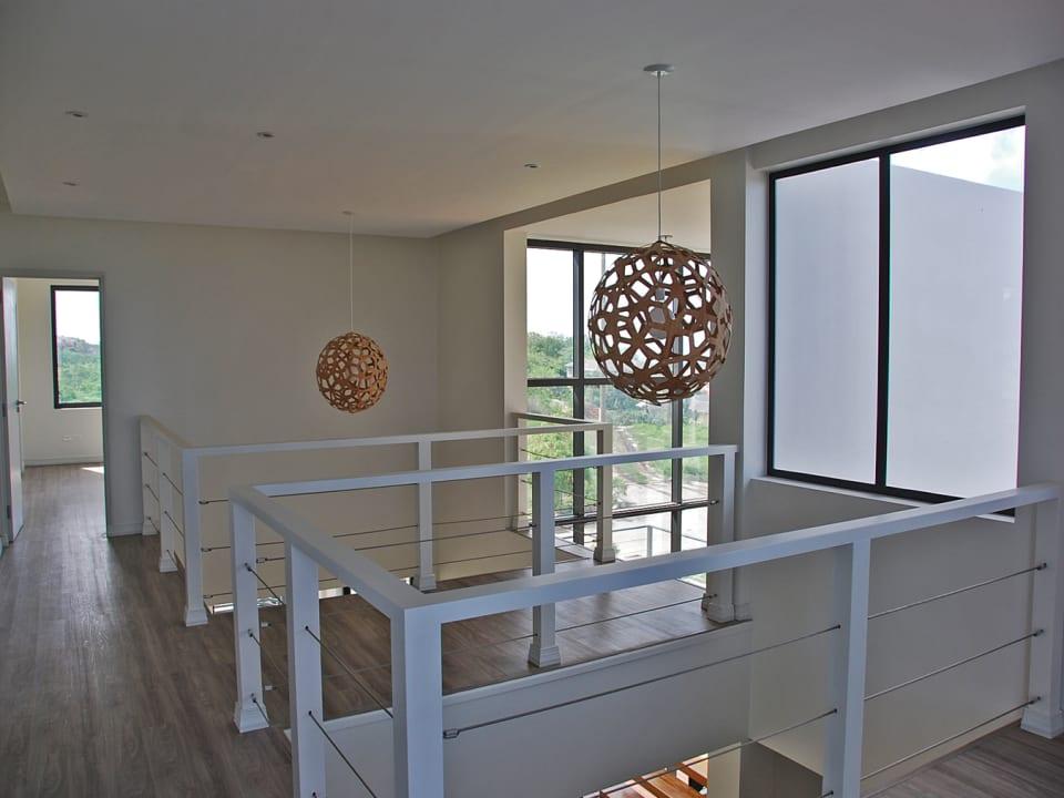 Upstairs landing area with playful light fixtures