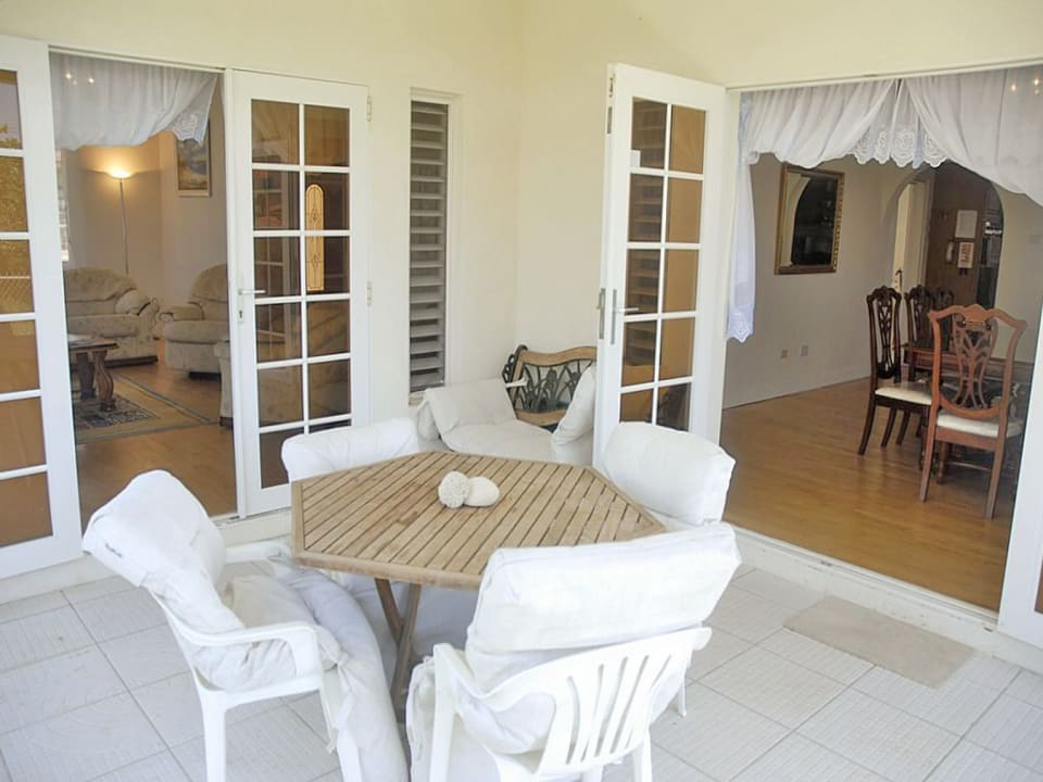 French doors from living & dining rooms open to this intimate patio