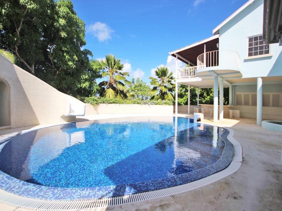 Pool with slide and bar