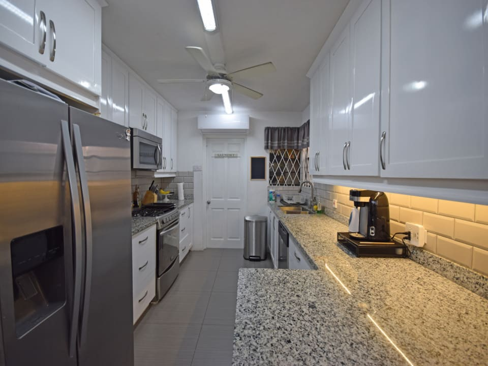 Modern kitchen leading to laundry