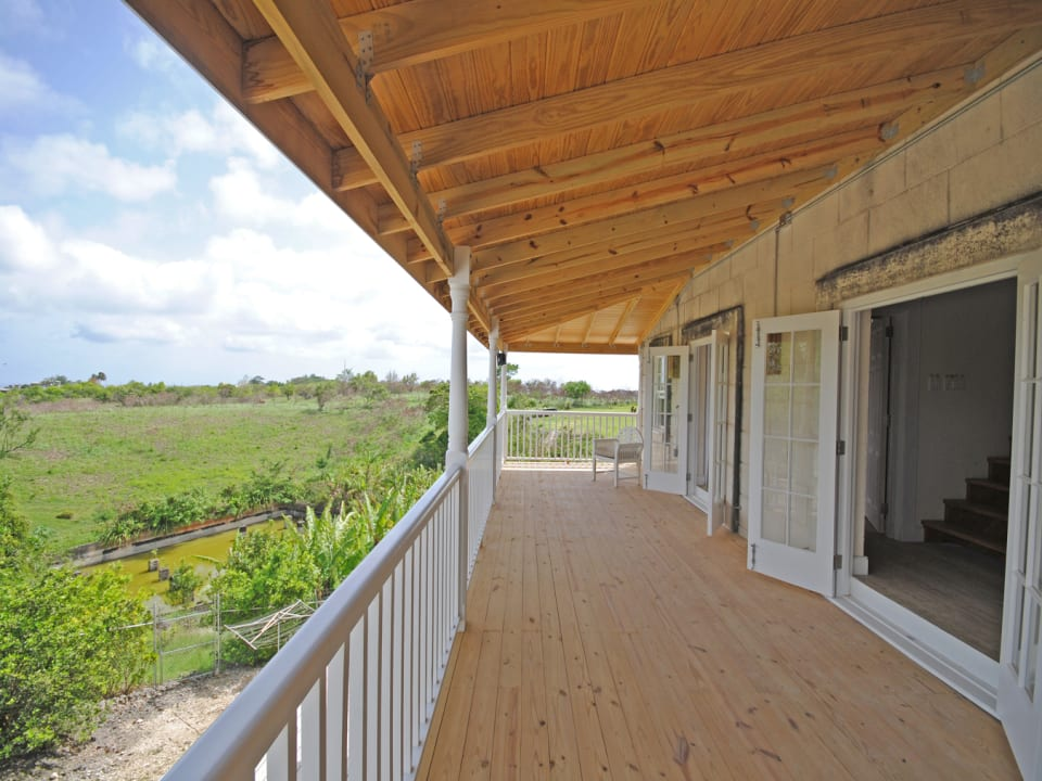 Large veranda with country and sunset views