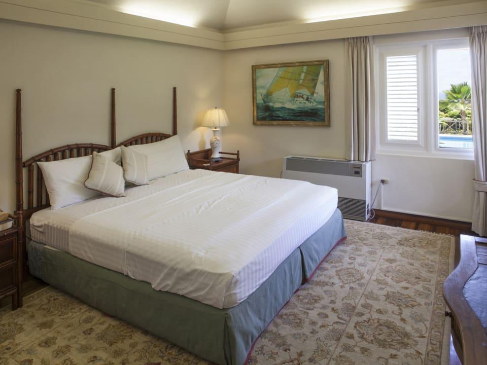 Guest bedroom on ground floor has pool views