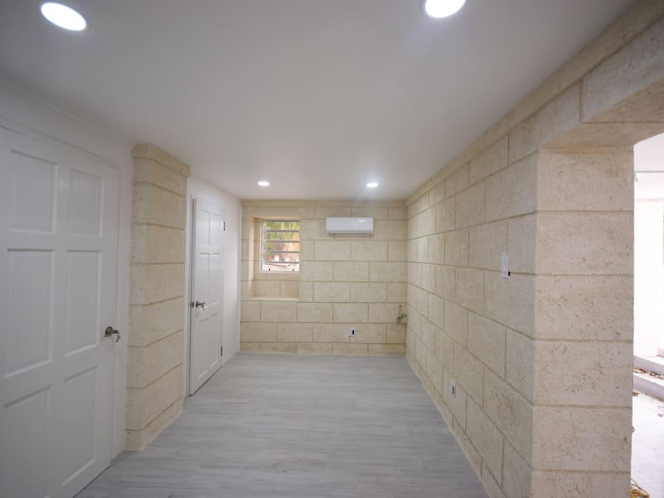 Hallway leading to kitchen & bathroom area