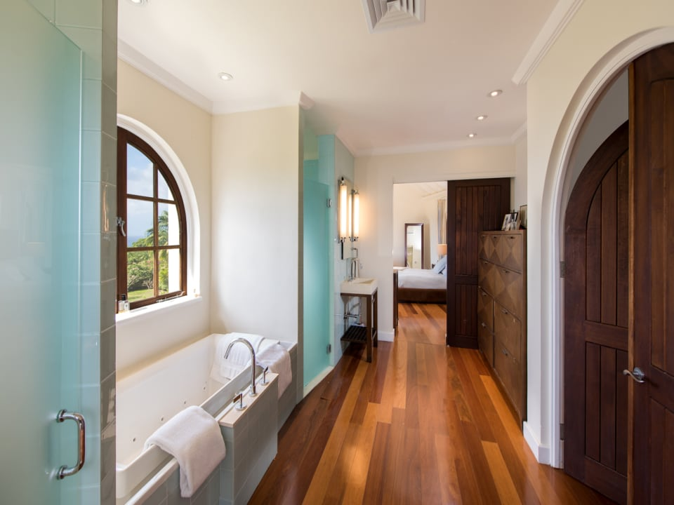 Spacious master bathroom with walk in closets and tub