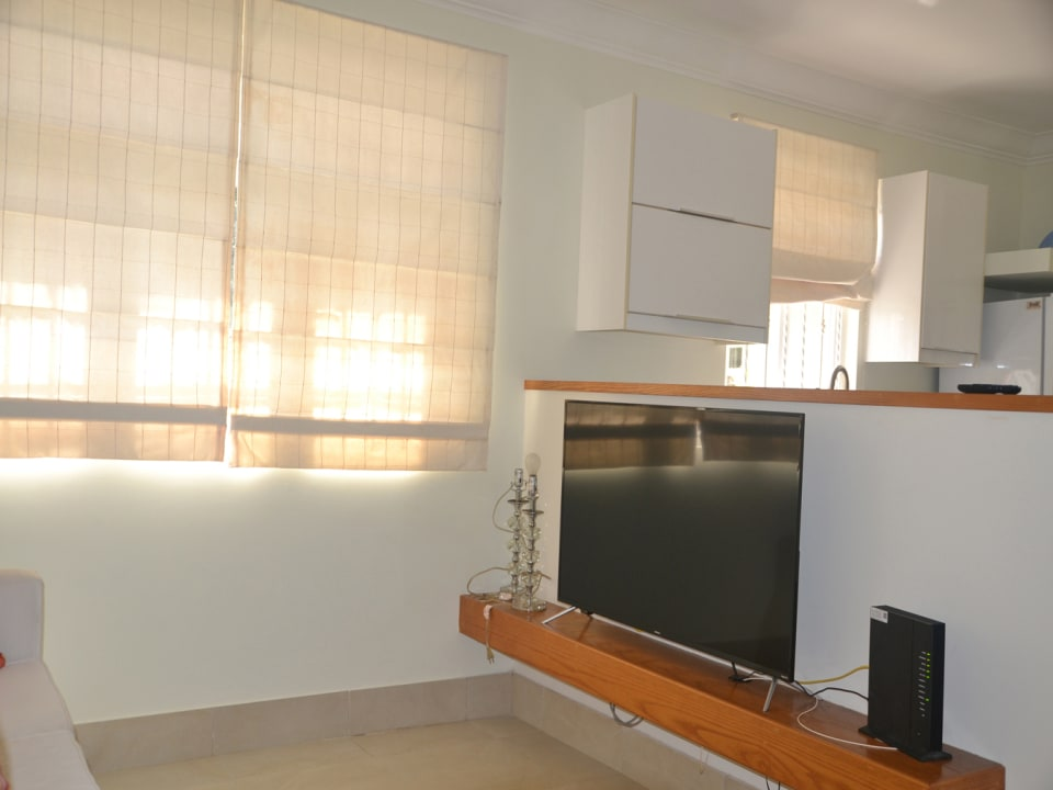 View of TV area and Kitchen