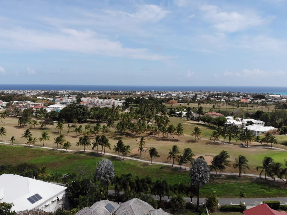 Aerial view of neighbourhood with sea view in the distance