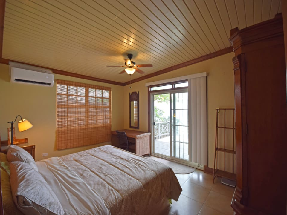 Master bedroom leading out to the balcony
