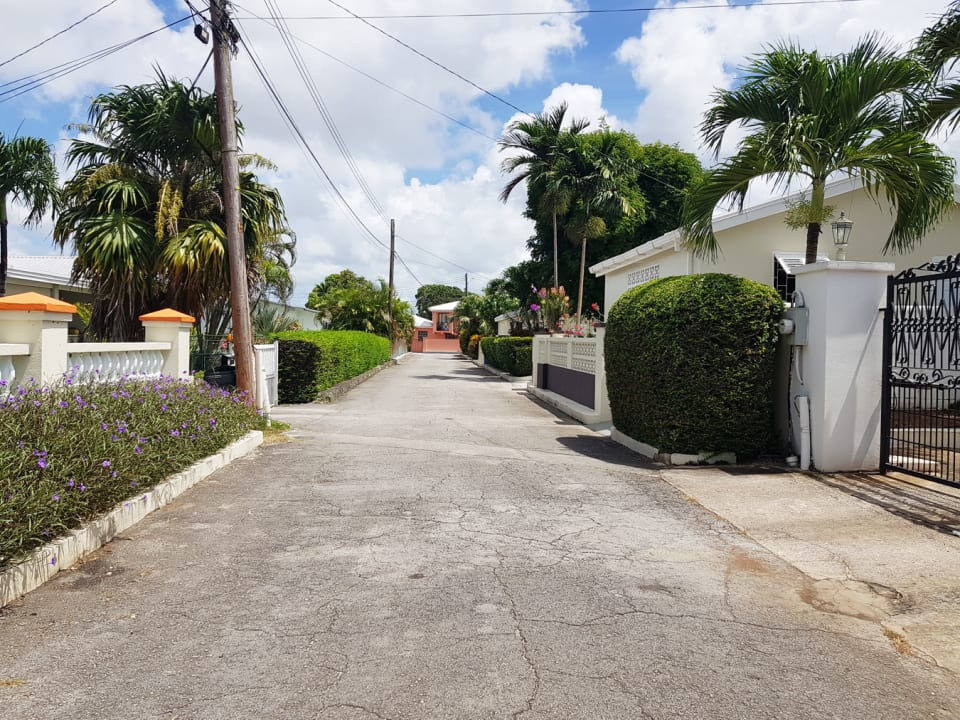Neighbourhood road view with electronic entrance gate