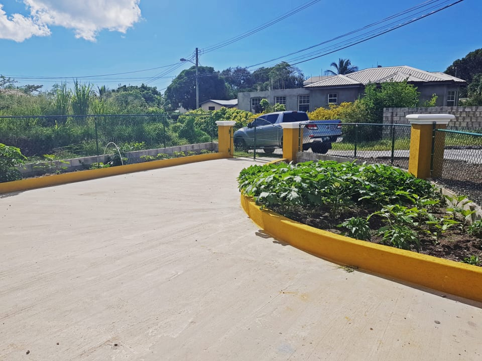 Parking area with vegetable garden