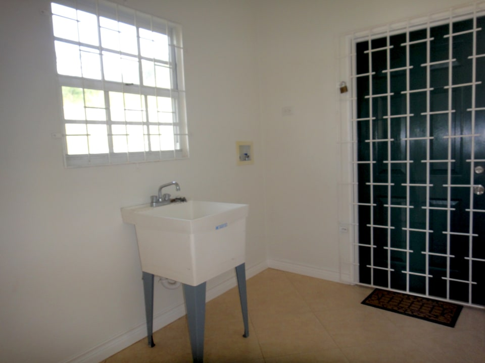 Laundry room with access to back garden