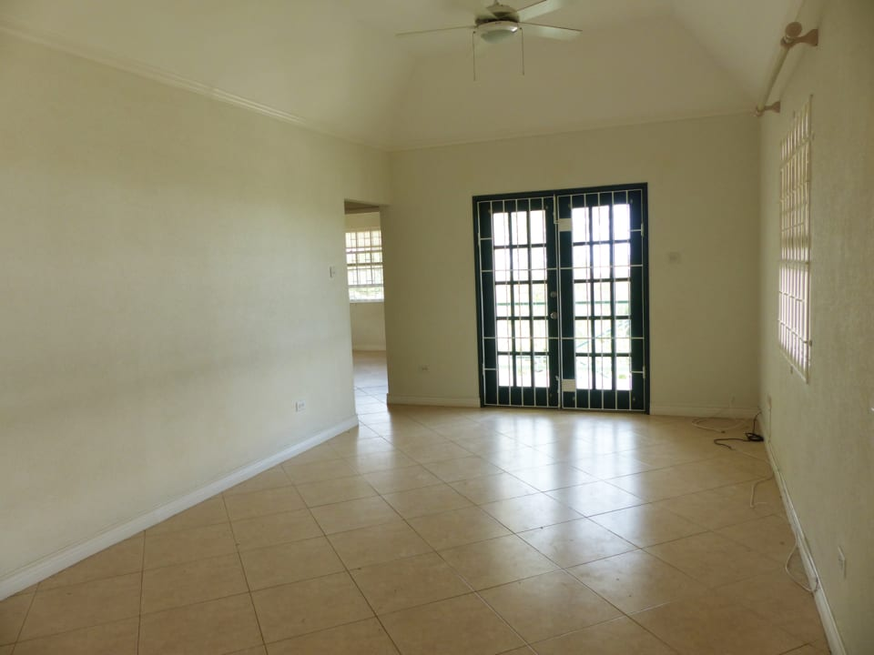 Living/dining area with french doors to terrace