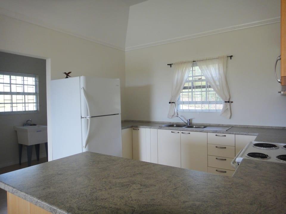 Kitchen adjoins laundry area