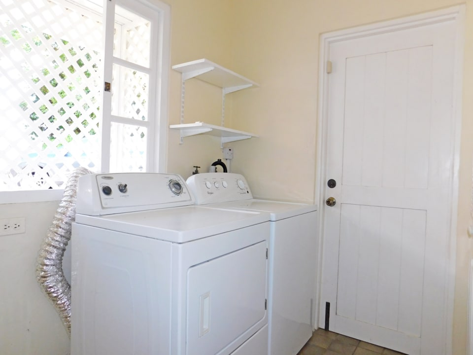 Laundry room with external exit