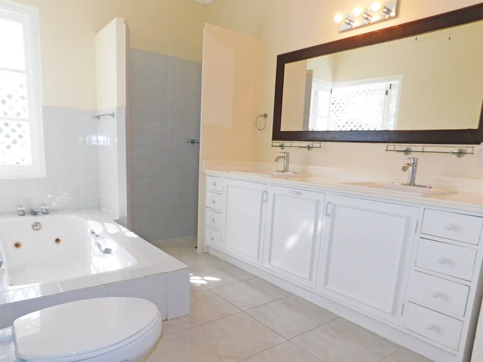 Main Bathroom with double vanity, shower and tub