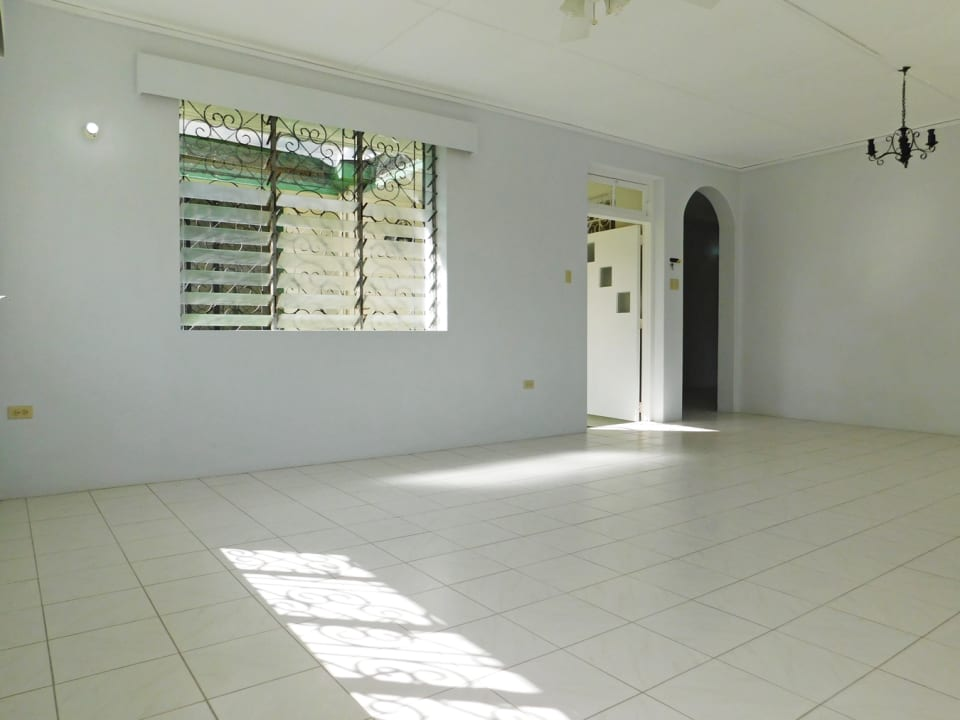 Living and dining area looking onto the entrance and internal corridor