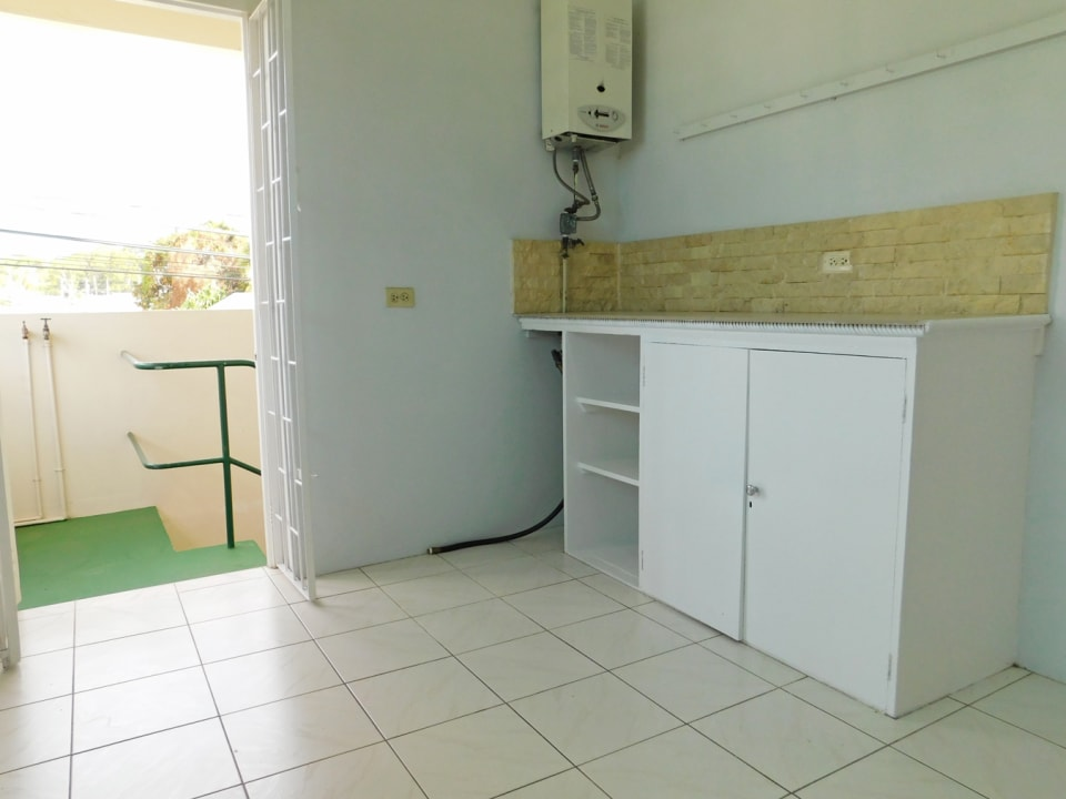 Kitchen with Gas hook up and washing machine fittings located on the external landing