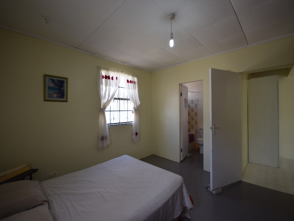 Bedroom with an ensuite bathroom