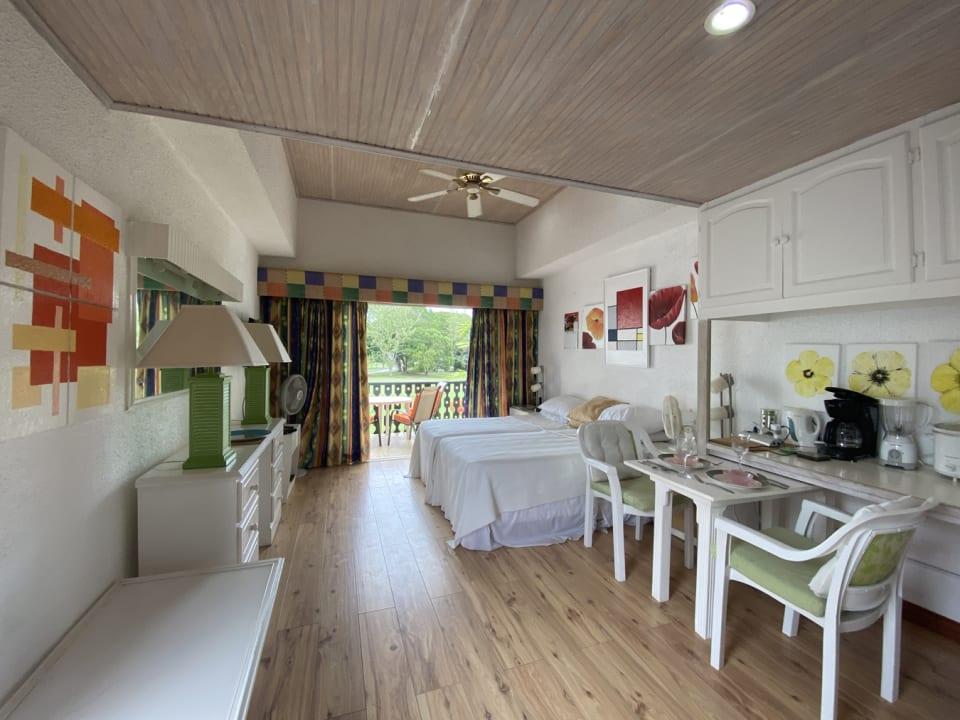 Open plan studio with terrace overlooking golf course