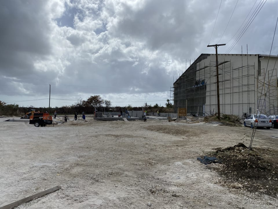 Warehouse under construction to left