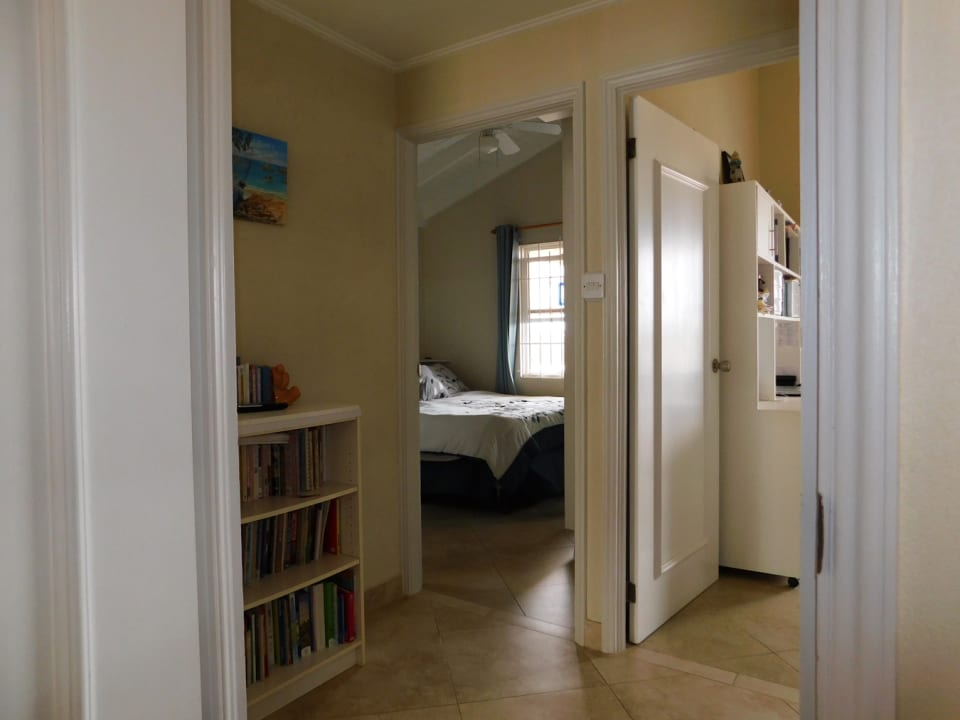 Hallway leading to all 3 bedrooms