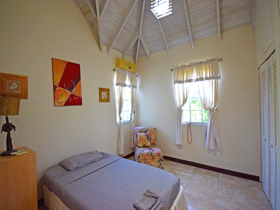 Guest bedroom with high ceilings