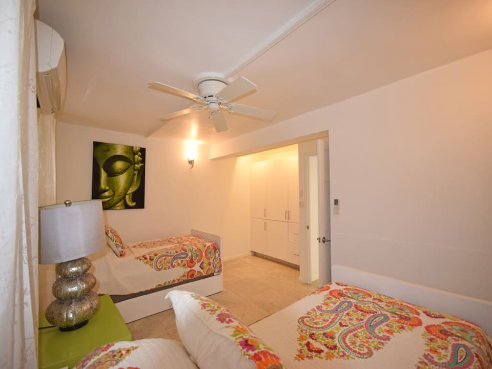 Spacious bedroom with twin beds