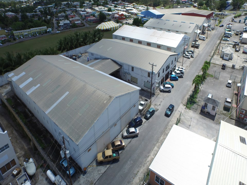 Aerial view showing some parking to the front of the building