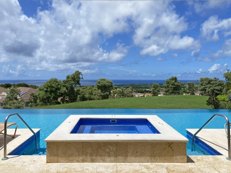 Large common pool with stunning sea views
