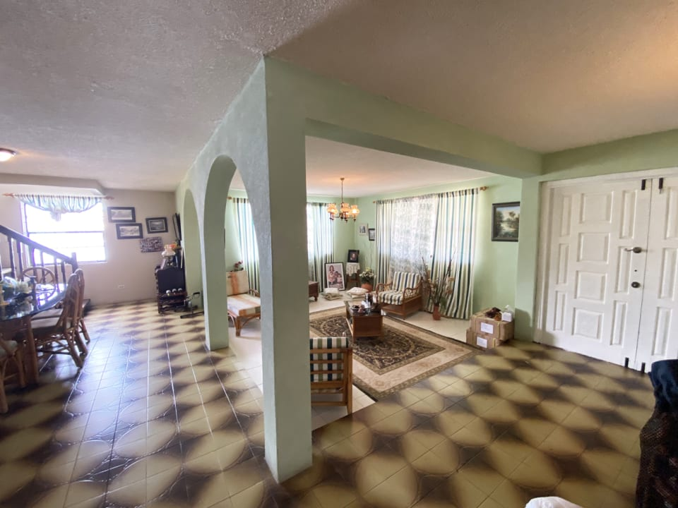 Great Room with stairs leading to first floor