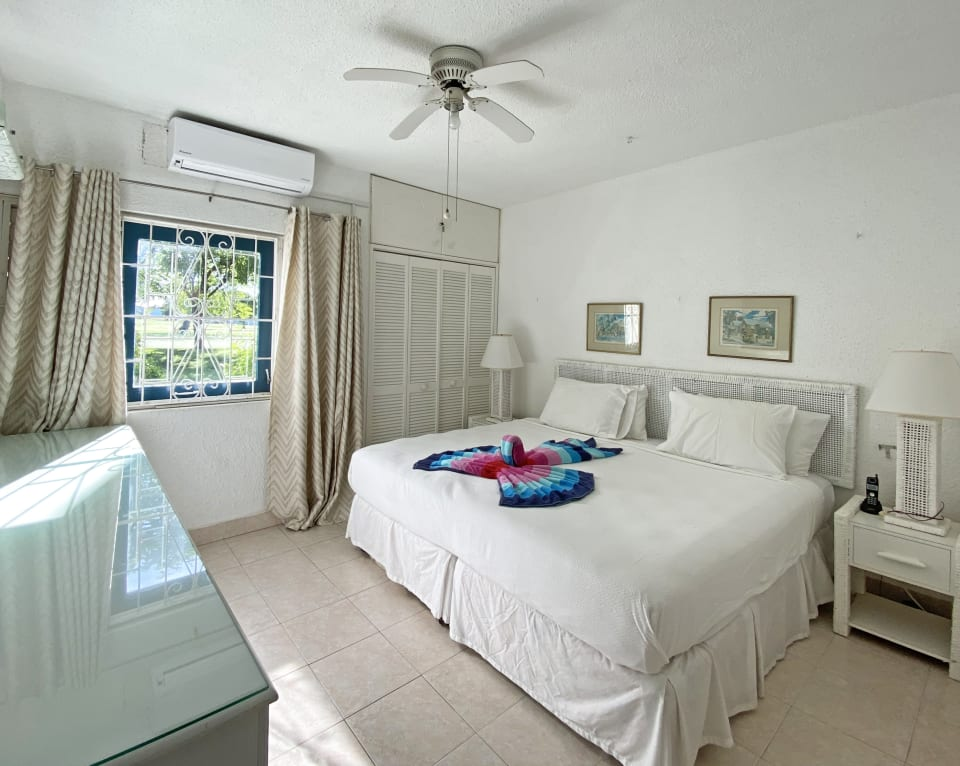 Main bedroom with a king sized bed