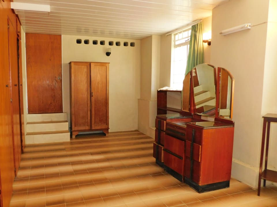 Bedroom in the apartment with a door leading to the storage
