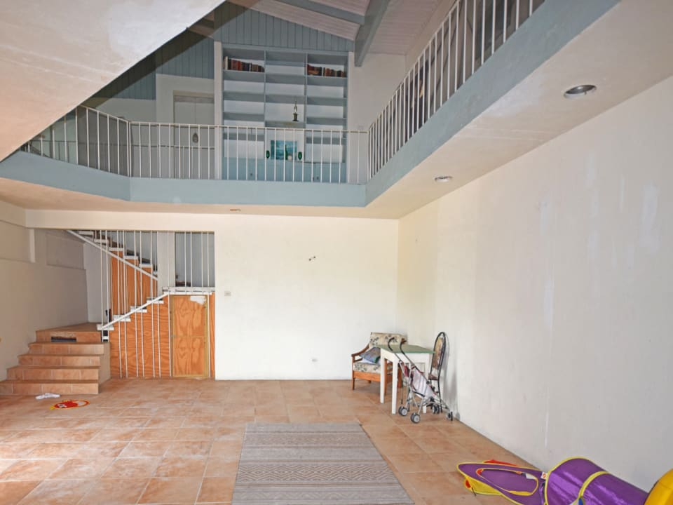 Ground floor living area leading to stairwell