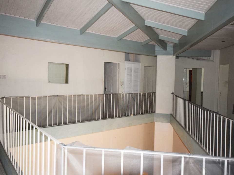 Atrium and access to bedrooms on upper level