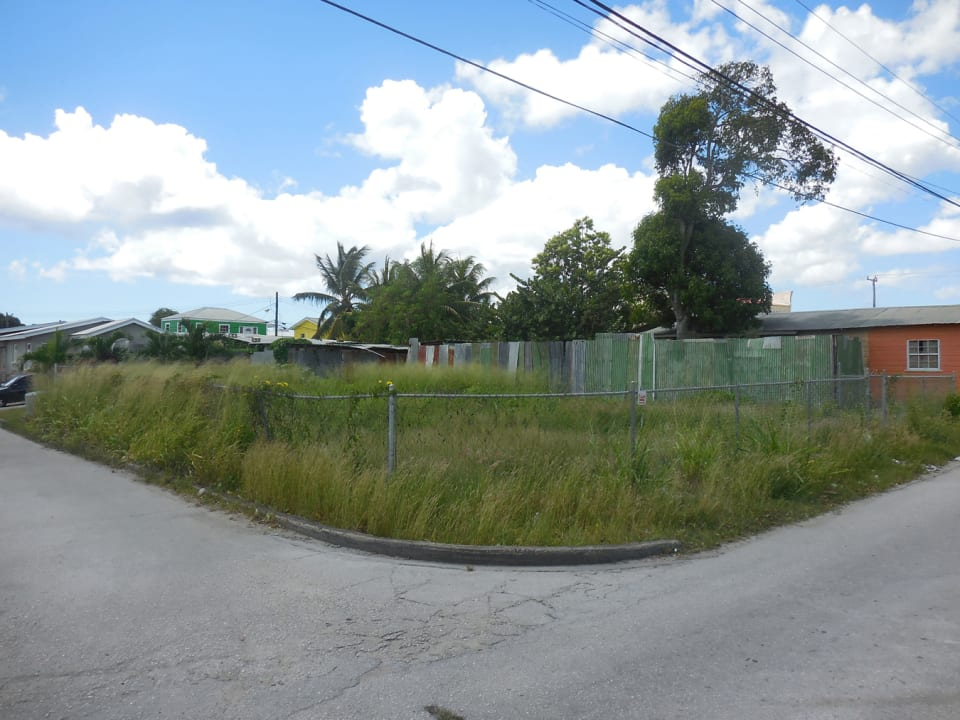 View of a vacant lot directly opposite the subject.