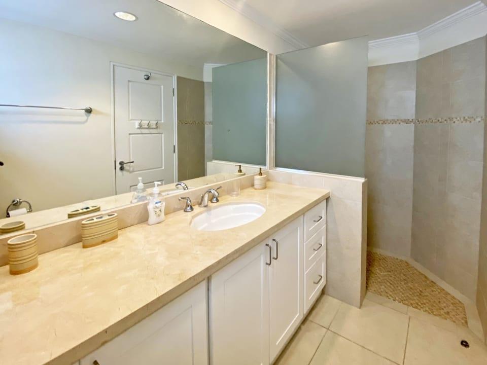 En suite guest bathroom with walk in shower