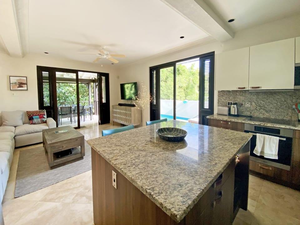 Modern kitchen adjoins living room