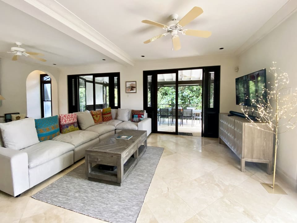 Comfortable living room opens to terrace