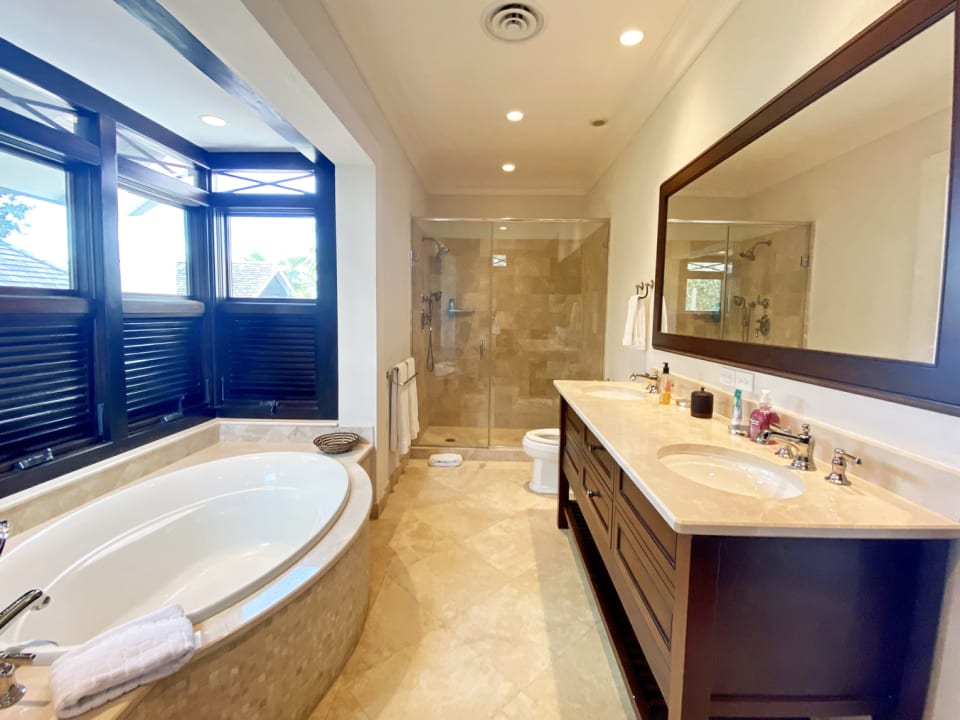Master bathroom with bath and walk in shower